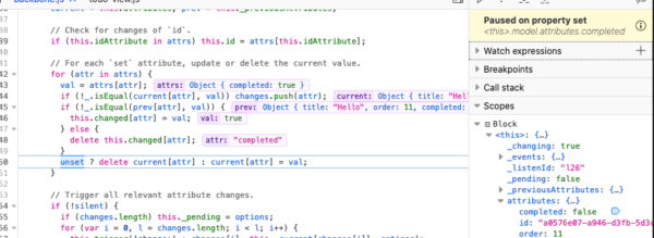 The JavaScript debugger is paused at a line of code where a property was set, due to a watchpoint on that property.